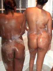 Two black girlfriend naked romp in the bathroom