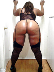 Hot black housewife shows her big black ass and fat legs..
