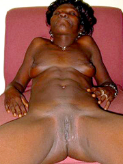Naked black afro whore spreads her old legs